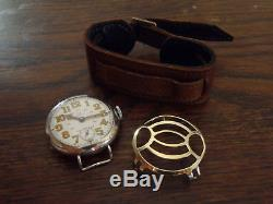 Large WWI 1915 Omega trench wristwatch in silver case, shrapnel guard, SERVICED