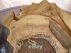 Original U. S. WW1 Helmet M1917 ZA195 with original WW1 USMC badge