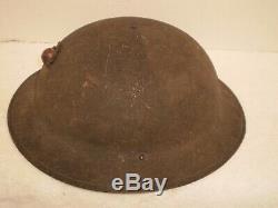 Original U. S. WW1 M1917 helmet, ZC257 with original WW1 USMC badge