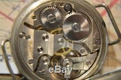 WW1 British Issued Broadarrow Trench Watch, small size, with shrapnel guard,