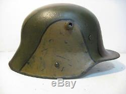 WWI German M17 Camo Helmet with aged liner